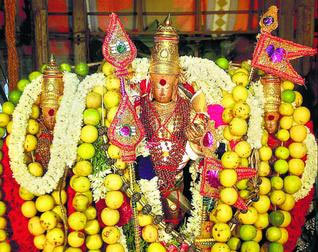 The deities of Lord Murugan with Goddess Valli and Deivanai adorning the temple car of Lord Subramaniaswamy Temple Tiruchendur